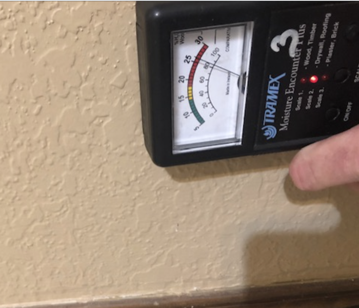 Moisture reading technology against affected wall.