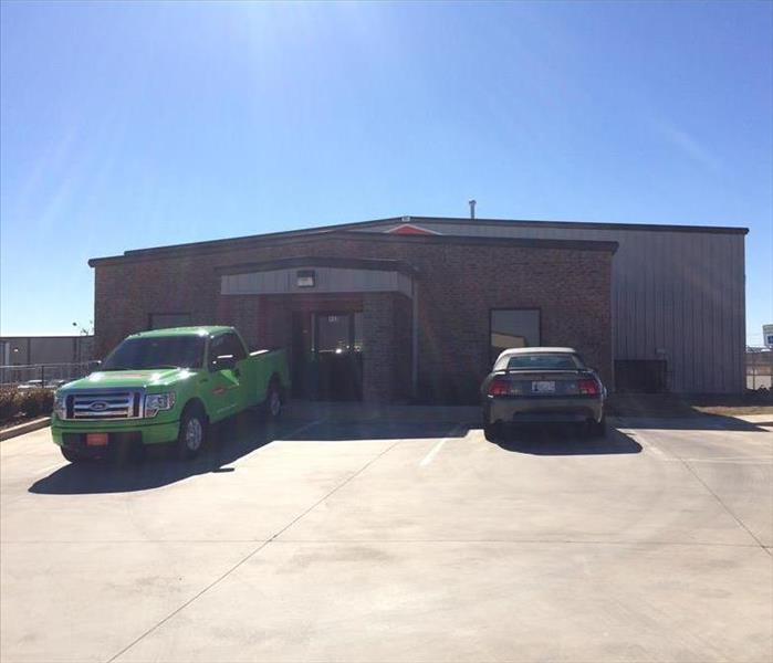 Front of SERVPRO structure with green SERVPRO truck out front.