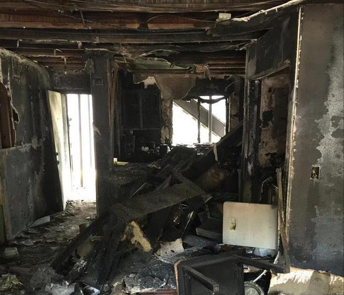 Severely fire damaged room.