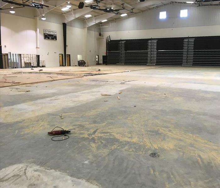 Removed flooring in large gym.