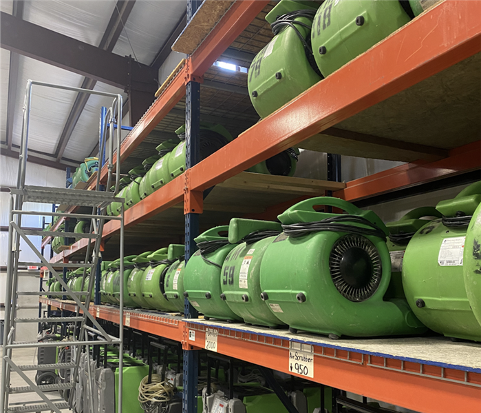Air movers in warehouse.