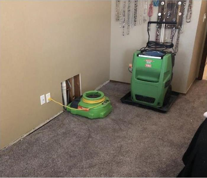 air mover and dehumidifier placed on a rug